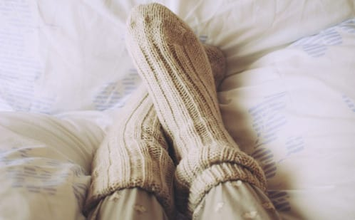 Warm socks against cold feet in bed